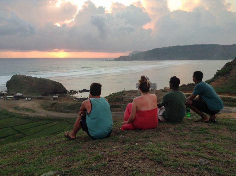 Keenan Hickman '14 and friends admire an Indonesian sunset.