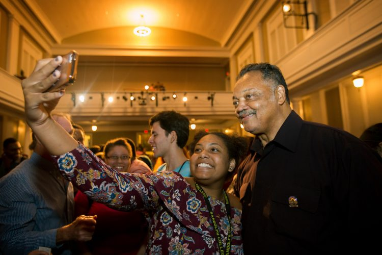 Students pose for photos with Rev. Jesse Jackson