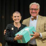 Carla Alexander '68 accepts her Alumnae Achievement Award from President Bradley W. Bateman.