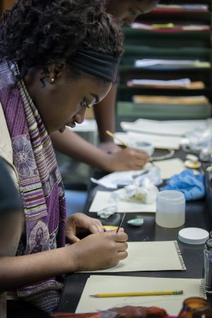 Ranita Opoku-Sarfo '21 participates in a special painting workshop based on the new exhibition.