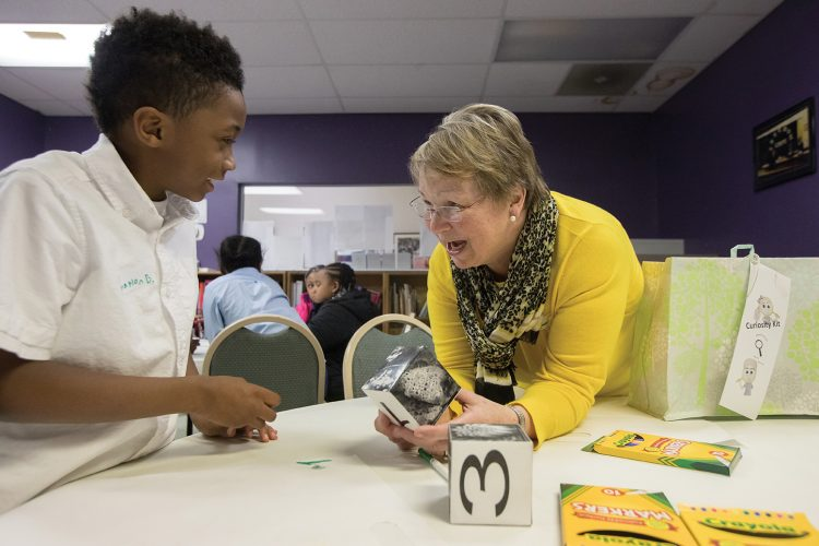 Cheryl Lindeman works with a Curiosity Club student at the Jubilee Family Development Center.