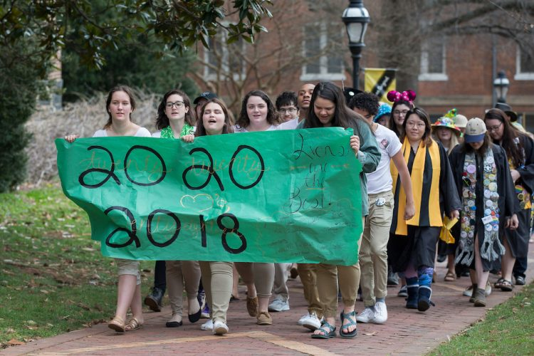 Sophomores carry the banner and lead the procession to the Sundial