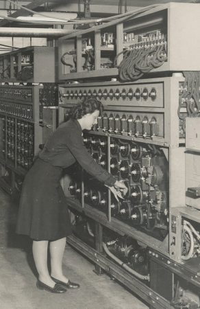A code breaker operates a bombe, which is an early computer that performed mathematical operations necessary to read enemy message traffic. (Photo courtesy of National Security Agency) mathematical operations necessary to read enemy message traffic. (Photo courtesy of National Security Agency)