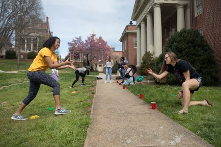 Students participate in an outdoor activity for a sport & exercise studies class