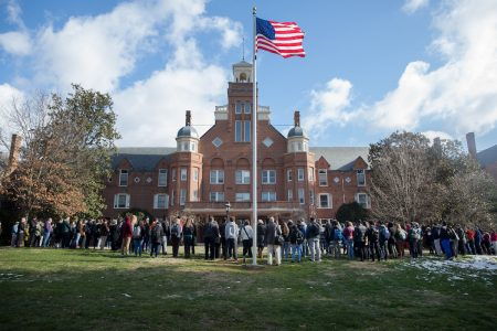 A large group of people gathered in front of Main Hall in observance of the national walkout protesting gun violence on March 14.