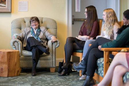 Sister Helen Prejean, left, sitting and talking with students