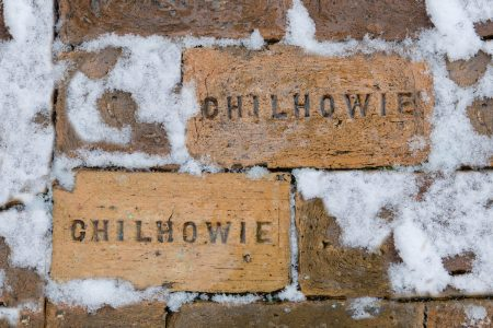"""Bricks with the word """"Chilhowie"""" on them, surrounded by snow"""