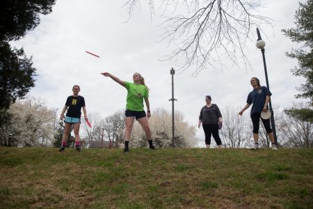 Sport & exercise studies students playing a game of frisbee golf