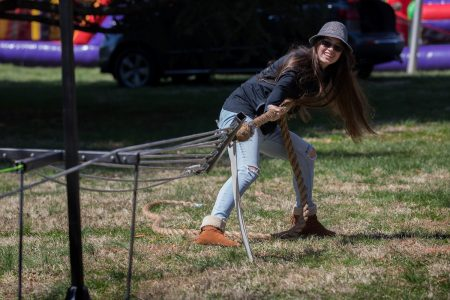 Student participates in a tug of war contest at Randolph College's Science Festival