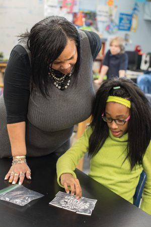 Tawanda Johnson '90 works with a student in Dearington Elementary's Curiosity Club
