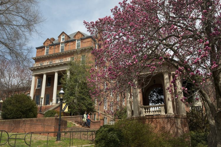 Spring flowers in front of the Engagement Tower and Moore Hall.