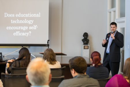 """Stuart Gossler '18 M.A.T. delivers his presentation, """"The Future of Learning History."""""""