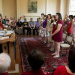 Phi Beta Kappa inductees stand as they are recognized as Phi Beta Kappa inductees