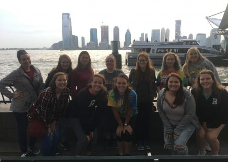 Randolph students on the ferry to Ellis Island in New York City, with skyscrapers in the background