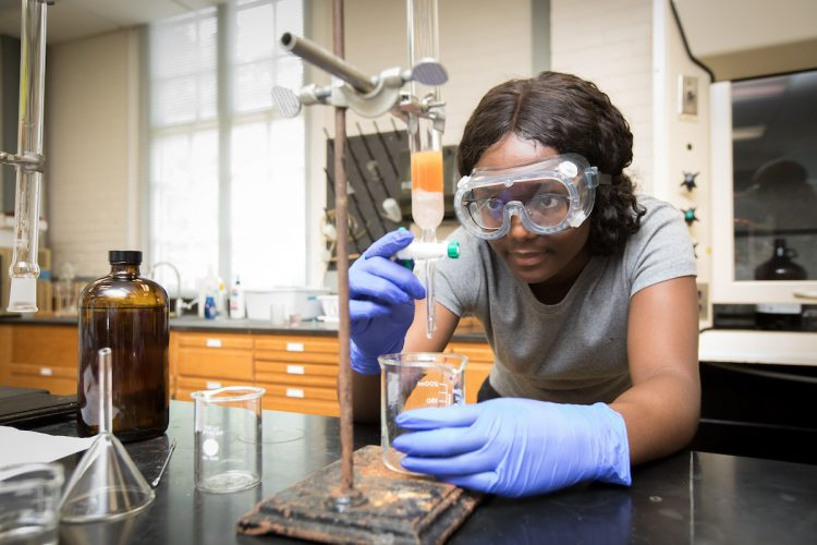 Valarie Osei-Akyeampong '19 works to extract pigment from a sample of rice