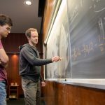 Jude Quintero '20 (left) and mathematics professor Michael Penn work on an equation