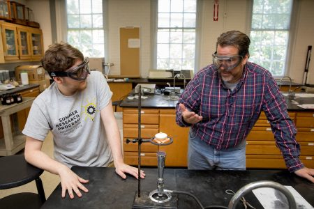 Matthew Williams '20 (left) and chemistry professor Bill Bare experiment on phosphoric material in the chemistry lab