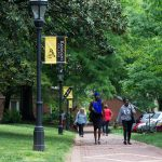 Students walking along the brick path on front campus