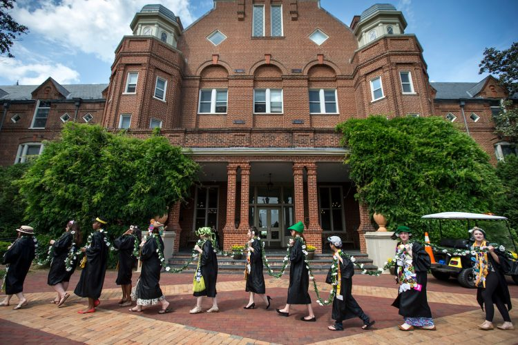 Students carry the Daisy Chain past Main Hall