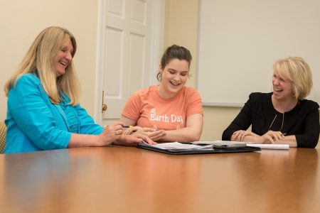 (Left to right) Christine Harriger, director of career development, Jessica Burroughs '18, and Kristin Dabney, alumnae and alumni career network manager, go over job search materials.