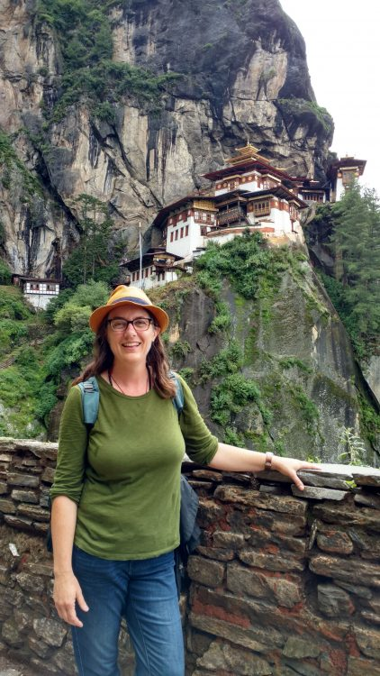 Professor Suzanne Bessenger in front of Tiger's Nest Monastery in Paro, Bhutan