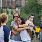 Alumnae embrace at Homecoming