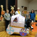 Randolph students pose with Maddie, age 6, in her Cinderella-themed costume,
