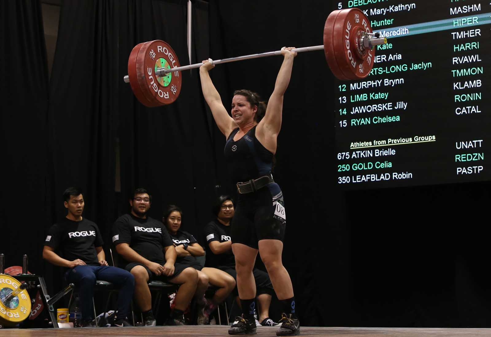 Meredith Alwine lifts 125 kg (275 lbs) during a clean and jerk at the 2017 American Open Finals in Anaheim, California, December 2017.