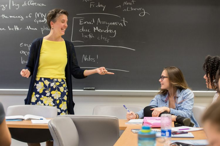 Philosophy professor Kaija Mortensen interacts with Olivia Chapin '22 during a classroom discussion about the meaning of Vita abundantior.