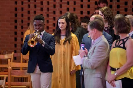 George Darko-Boateng '20 performs on trumpet at the 2018 baccalaureate service