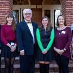 Mid-year graduates with President Bradley W. Bateman