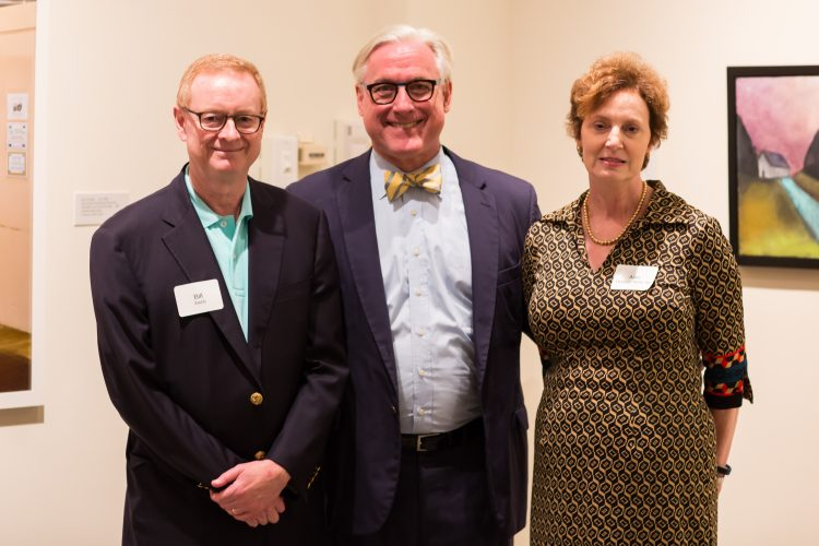 Bill and Ann Hepburn Webb '84 with President Bradley W. Bateman (center)