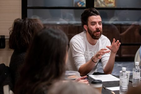 M.F.A. faculty member Kaveh Akbar leads a workshop for poetry students during their winter residency.