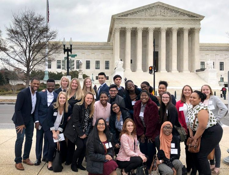 Randolph students with Rashan Colbert '11 in front of the Supreme Court building in Washington, D.C.