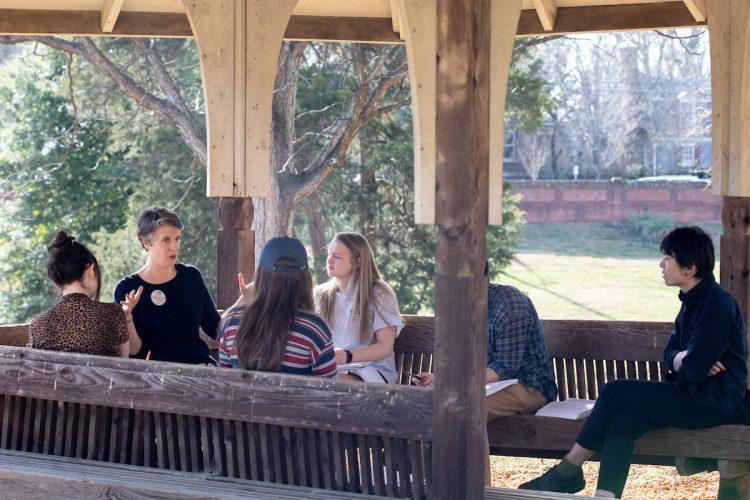 Professor Kaija Mortensen teaches class in the gazebo on front campus
