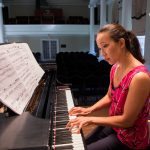 Emily Chua playing piano in Wimberly Recital Hall at Randolph