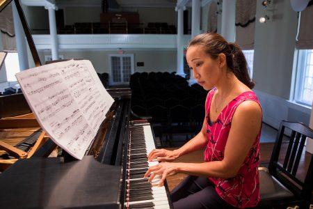 Emily Chua playing piano in Wimberly Recital Hall at Randolph