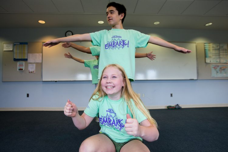 Students in line making poses at Embark Theatre Camp