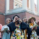 Seniors will wear their graduation robes (decked out in buttons) and funny hats to the ceremony