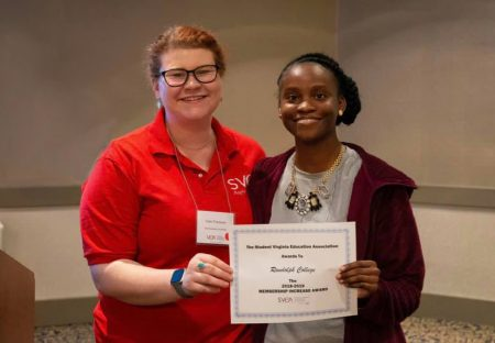 Ke'Asia Carter '19 M.A.T. (right) accepts the Highest Membership Increase award from SVEA President Catie Travassos.