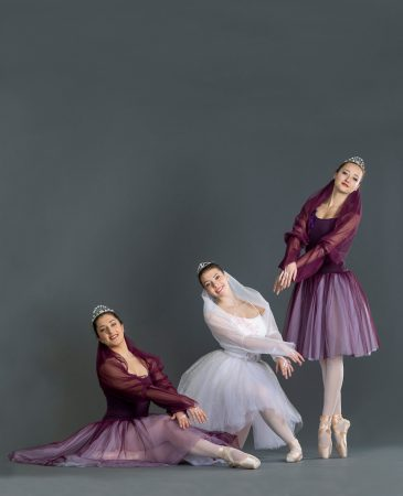 Three dancers posing for a photo