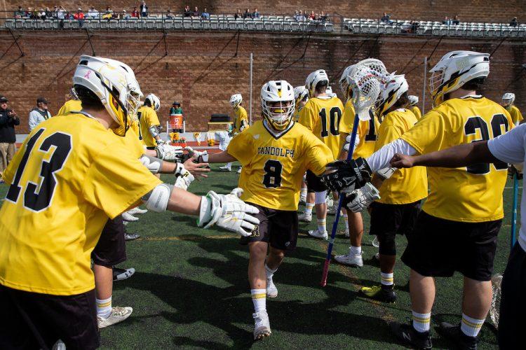 The WildCat men get ready for a lacrosse game versus Methodist
