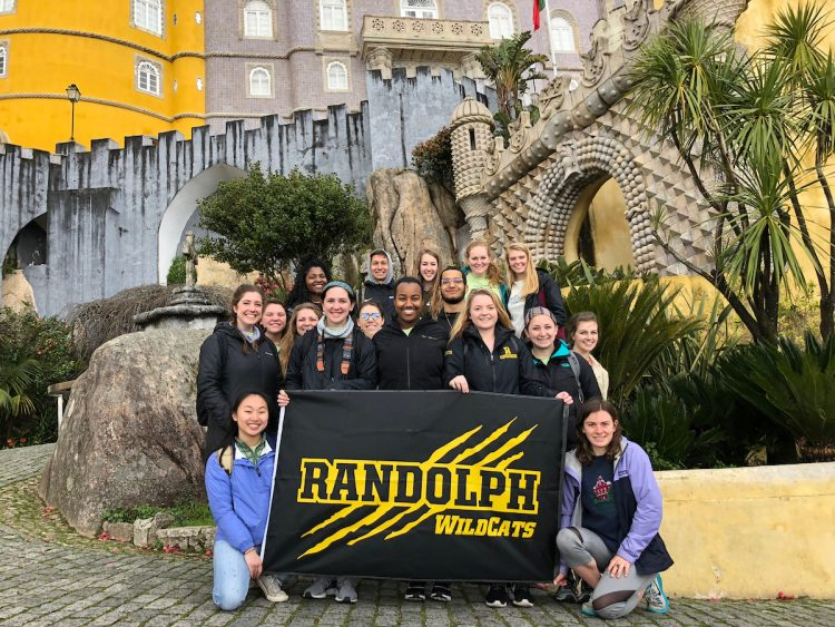 Students hold the Randolph WildCats banner in Sintra