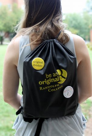 A Randolph College student shows off her Be An Original backpack and button collection.