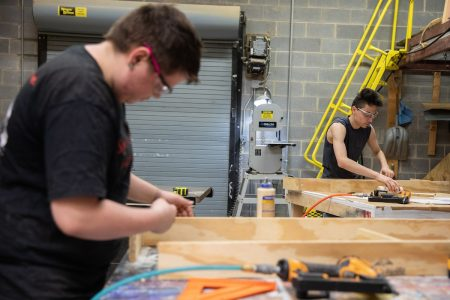 Dakota Willard (left) and Chris Perez worked as carpentry apprentices for the production