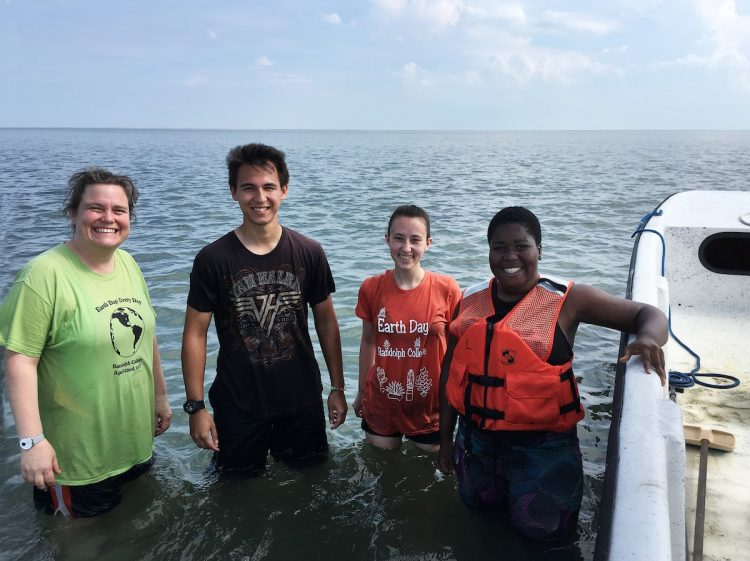 (From left) professor Sarah Sojka, Alex Kulvivat, Paige Edwards, and Jdody Misidor in the water along the eastern shore of Virginia.