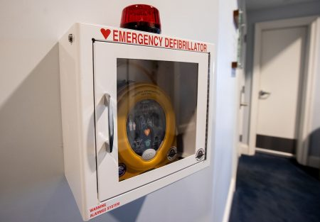 Each AED gives audible, step by step instructions for how to treat a victim of cardiac arrest and shows where to place the equipment.