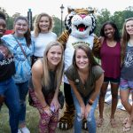 Alumnae pose with Wanda WildCat during the tailgate event