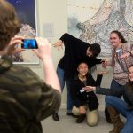 Students take photos and selfies with art in the Maier as part of a Science + Art Saturdays activity