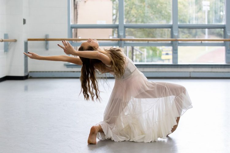 Emma Carrico practices a solo routine in the dance studio for the upcoming concert
